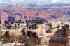 Tourists admire the Grand Canyon.