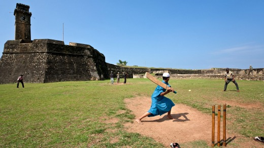Boys playing cricket. Galle Fort.