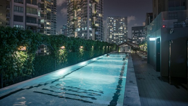 The pool is on an open-air deck above the Singapore River.