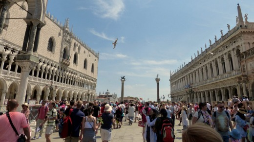 Tourists flock to St Mark's Square.