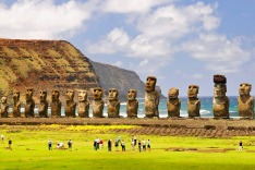 Tourists visit the Moais of Ahu Tongariki on Easter Island, Chile.