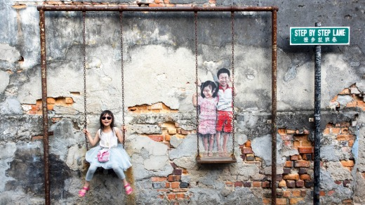 'Children on the Swing' street art by local artist Louis Gan in George Town, Penang, Malaysia.