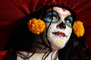 A woman dressed as Mexico's iconic 'Catrina' awaits the start of the grand procession of the Catrinas, part of the Day ...