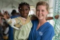 Mercy Ships ward nurse Theresa Bode takes a patient for a walk on deck.
