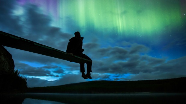 See the Aurora Borealis in Canada's Northwestern Territories.