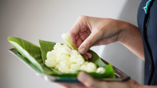 The fragrant tiare flowers are offered to every passenger.