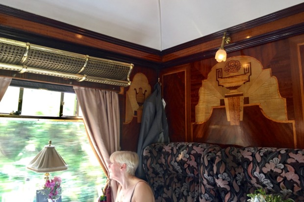 Lucille's distinct Art Deco marquetry of Grecian urns on dyed green holly wood on the Belmond British Pullman.