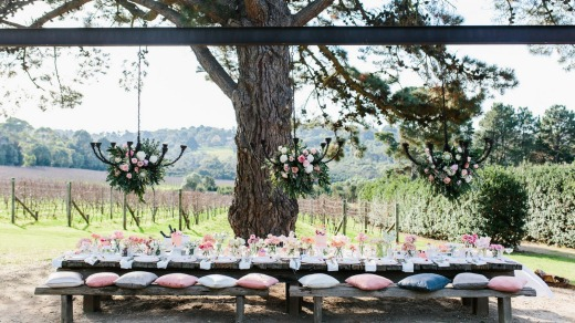 Outdoor dining overlooking the vineyard at Tussie Mussie Vineyard Retreat.
