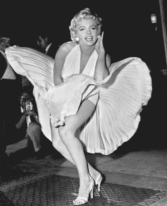 "Marilyn Monroe poses over the updraft of New York subway grating while in character for the filming of ""The Seven Year ..."