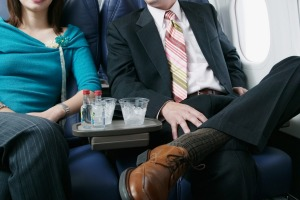 The strangers may face misdemeanor or felony charges over the in-flight sex act.