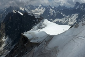 Ice trails. Trekkers climb to the summit of Mont Blanc, the highest peak in Europe.