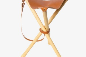 This classic tripod stool folds down.