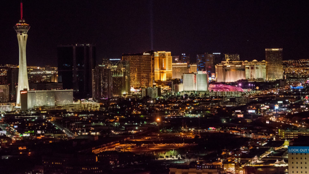The Stratosphere Casino, Hotel & Tower, left, and hotels stand on The Strip in this aerial photograph taken at night above in Las Vegas, Nevada, U.S., on Wednesday, Aug. 5, 2015. More than 21 million people have visited Las Vegas in the first half of 2015, about 1.5 percent more than a year ago when the destination recorded more than 40 million travelers for the first time according to tourism officials. Photographer: David Paul Morris/Bloomberg CREDIT LINE MUST READ: BLOOMBERG