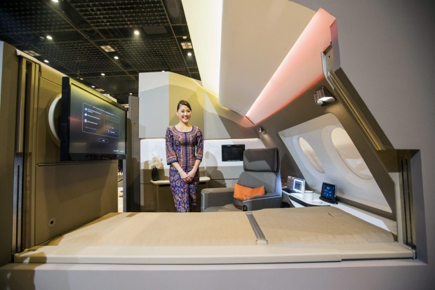 A flight attendant with a mock-up first class suite during the unveiling in Singapore.