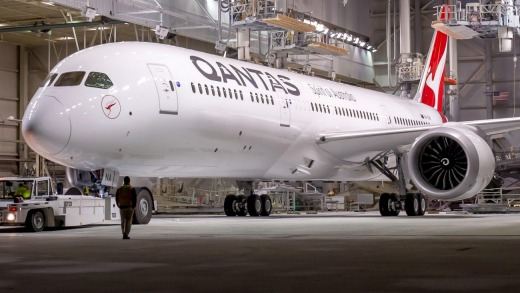 A Qantas 787-9 Dreamliner rolls out at the Boeing factory in Everett.