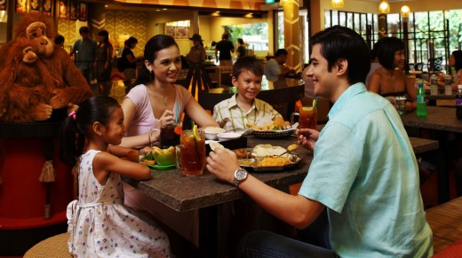 A family relaxing at Singapore Zoo.