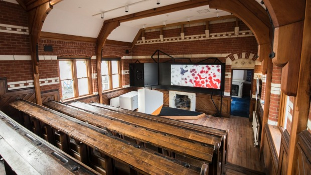 The restored lecture theatre is a great example of heritage features blending with new technology.
