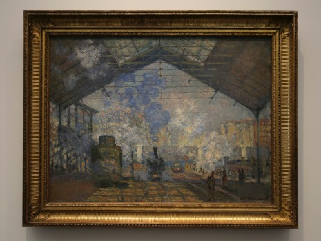 """In this Monday, Nov. 6, 2017 photo, """"Saint Lazare Train Station"""" by Claude Monet, is displayed at the Louvre Museum in ..."""