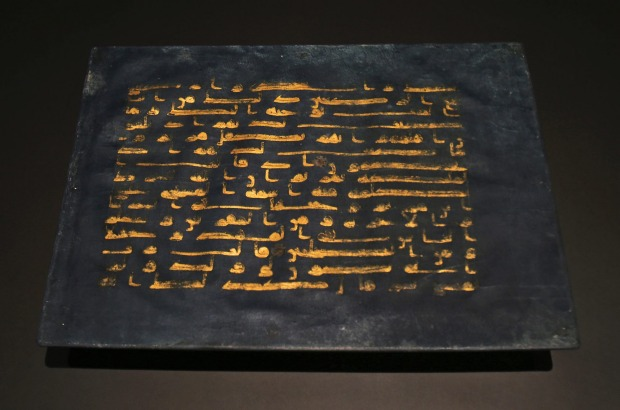 """A page of the """"Blue Quran"""" from north Africa about 900, is displayed at the Louvre Museum in Abu Dhabi, United Arab Emirates."""
