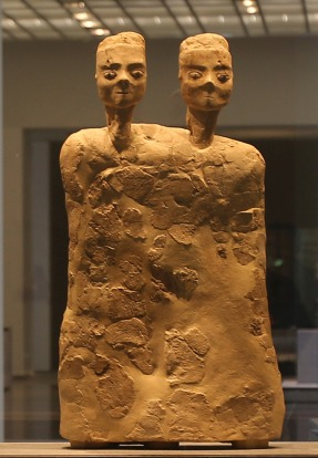"""The """"Monumental Statue with two heads"""" from Jordan about 6500 BCE, is displayed at the new Louvre Museum in Abu Dhabi, ..."""