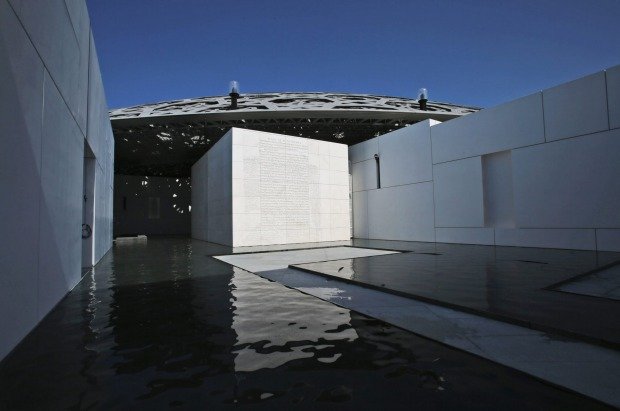 A limestone relief by American artist Jenny Holzer is seen at the Louvre Abu Dhabi, United Arab Emirates.