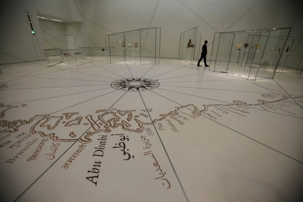 A man walks at a gallery of the Louvre Abu Dhabi, United Arab Emirates.