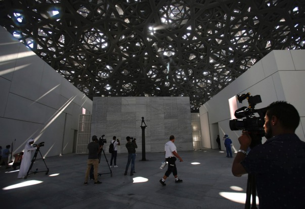 Members of the media walk around the sculptures in the Louvre Abu Dhabi in Abu Dhabi, United Arab Emirates.