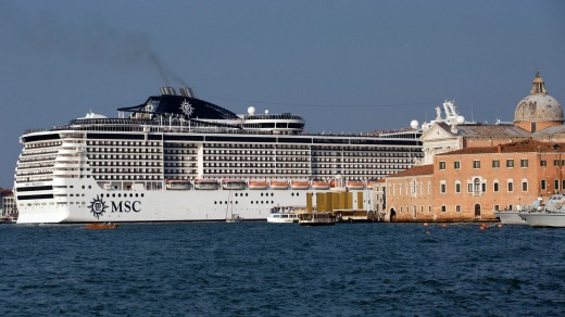 FILE - In this Sept. 27, 2014 file photo a cruise ship transits in the Giudecca canal, in The Italian government and ...