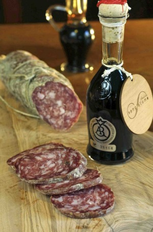 Locally produced salami and balsamic vinegar in a local shop.