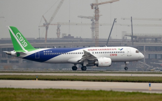 THE C919'S FIRST FLIGHT. The Chinese C919 passenger jet takes off on its first flight at Pudong International Airport in ...