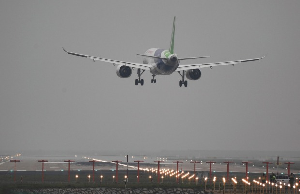 A Comac C919, China's first large passenger jet, coming in for a landing on its maiden flight at Shanghai's Pudong ...