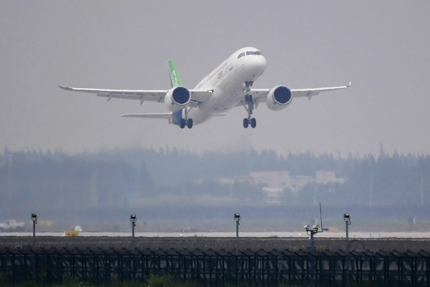 A Chinese C919 passenger takes off on its maiden flight at Pudong International Airport in Shanghai, Friday, May 5, 2017.