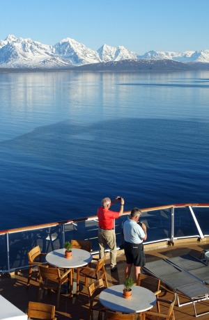 Passengers on the World Cafe deck during the approach to Tromso.