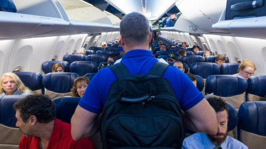 Take bags off of your shoulder, especially backpacks, before walking down the plane aisle.