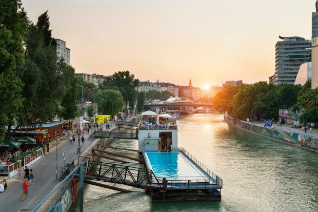 BADESCHIFF, VIENNA. Lash two barges together on a canal off the Danube River, fill with water, tack on a restaurant, a ...