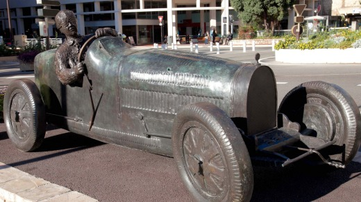 The bronze statue of British bolter William Grover-Williams at the wheel of his Bugatti 35B.