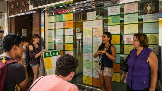As other tourists flock to wealthy shopping districts, some learn from guides like Lau about Hong Kong's underpaid ...