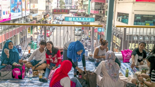 A meeting point for Hong Kong Free Tours and also where domestic workers gather to spend their day off, on a skybridge ...