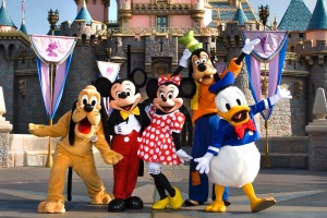Classic Disney characters welcome visitors outside the Sleeping Beauty Castle at Disneyland.