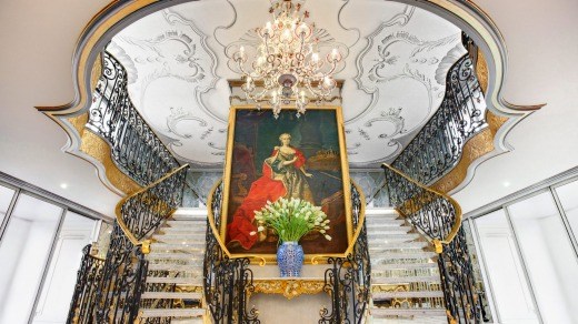 The lobby of Maria Theresa, with a portrait of the Austrian empress.