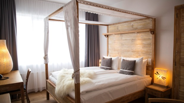 The linen on the four-poster bed is 100 per cent white cotton, and there are two down duvets -- one for each side of the bed!