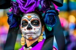 A young woman, dressed as La Catrina, performs during the Day of the Dead festival in Mexico City, Mexico.