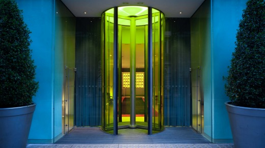 The yellow glass revolving doors of St Martins Lane, London.