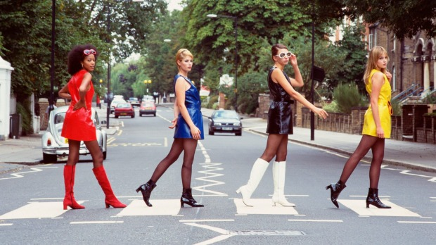 Tourists recreating the famous Beatles album cover, Abbey Road.