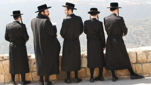 Orthodox Jews pray at the ancient old cemetery.