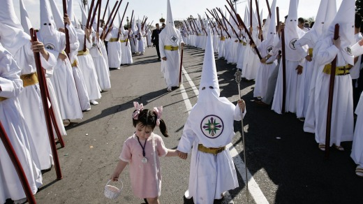 "Penitents of ""San Gonzalo"" brotherhood participate in a Holy Week procession in Seville, southern Spain. Hundreds of ..."