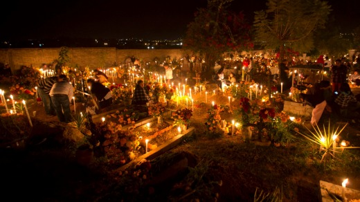 Family and friends gather at the graves of their departed loved ones during Day of the Dead celebrations in Atzompa, ...