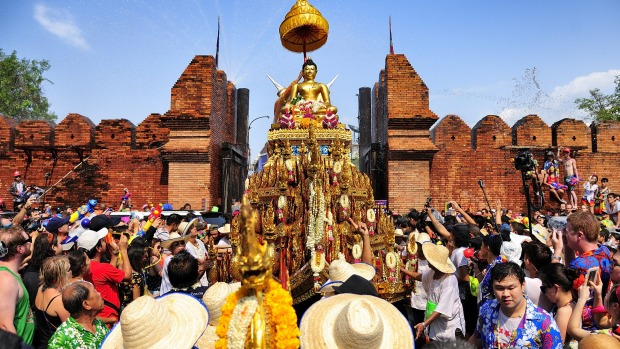 Chiang Mai Songkran festival: The tradition of bathing the Buddha Phra Singh.
