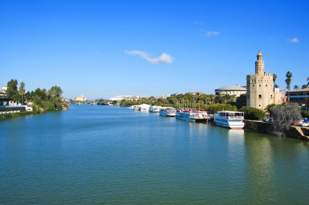 GUADALQUIVIR RIVER: Passengers on all but the smallest ocean ships face a long shore-excursion transfer to inland ...