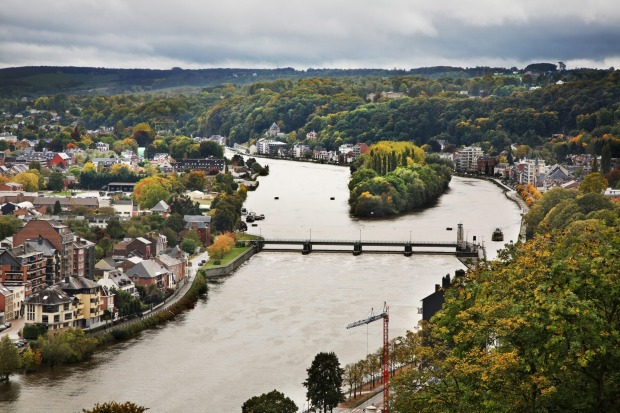 MEUSE RIVER: The Meuse River and its interconnecting canals and waterways provide a slow meander through the big-cloud ...